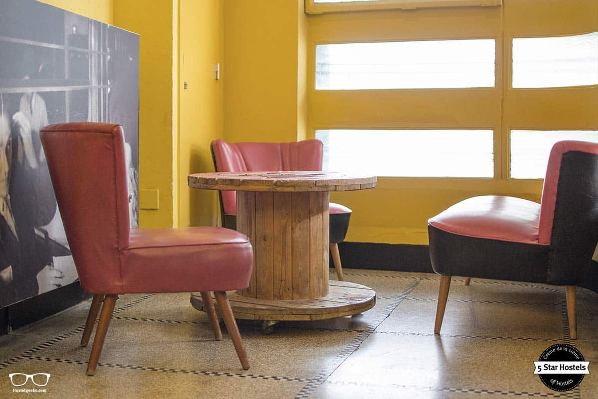 Upcycled tables in the living room at Backstay Hostel in Ghent