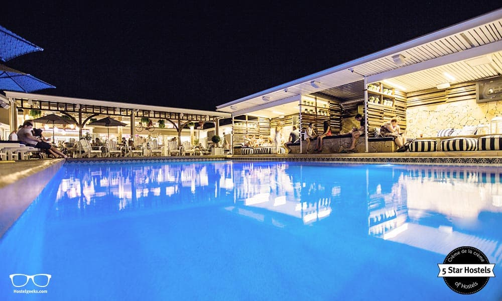 The blue-color swimming pool by night at Rambutan Townsville