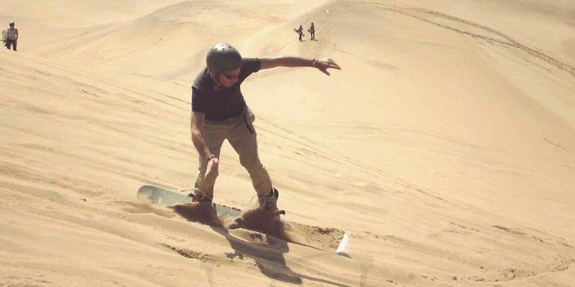 Sandboarding with 65k through Namibias Dunes