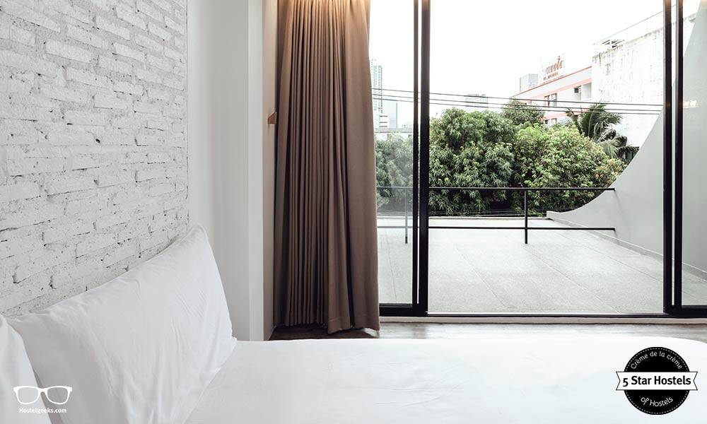 A Double room with private balcony at Yim Huai Khwang Hostel