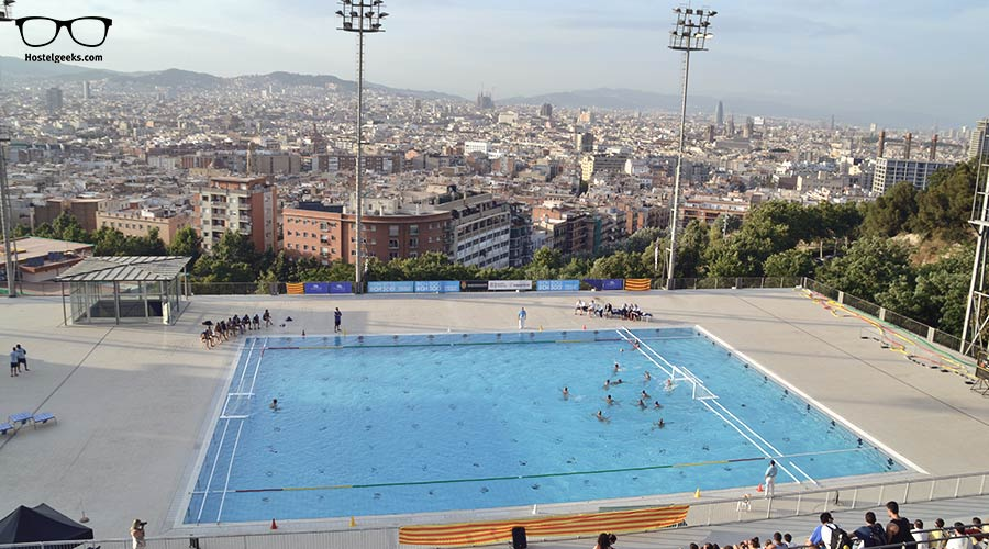 Dive in a swimming pool with overview to Barcelona