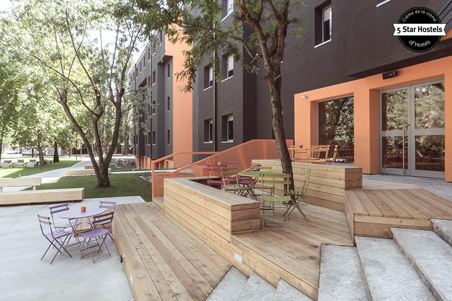 The outdoor area and terrace in front of WE Bologna Hostel