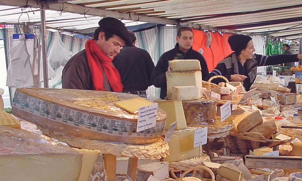 Buy a cheese in a Parisian market