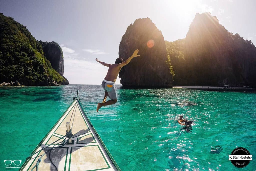 Jump in the blue water of Palawan