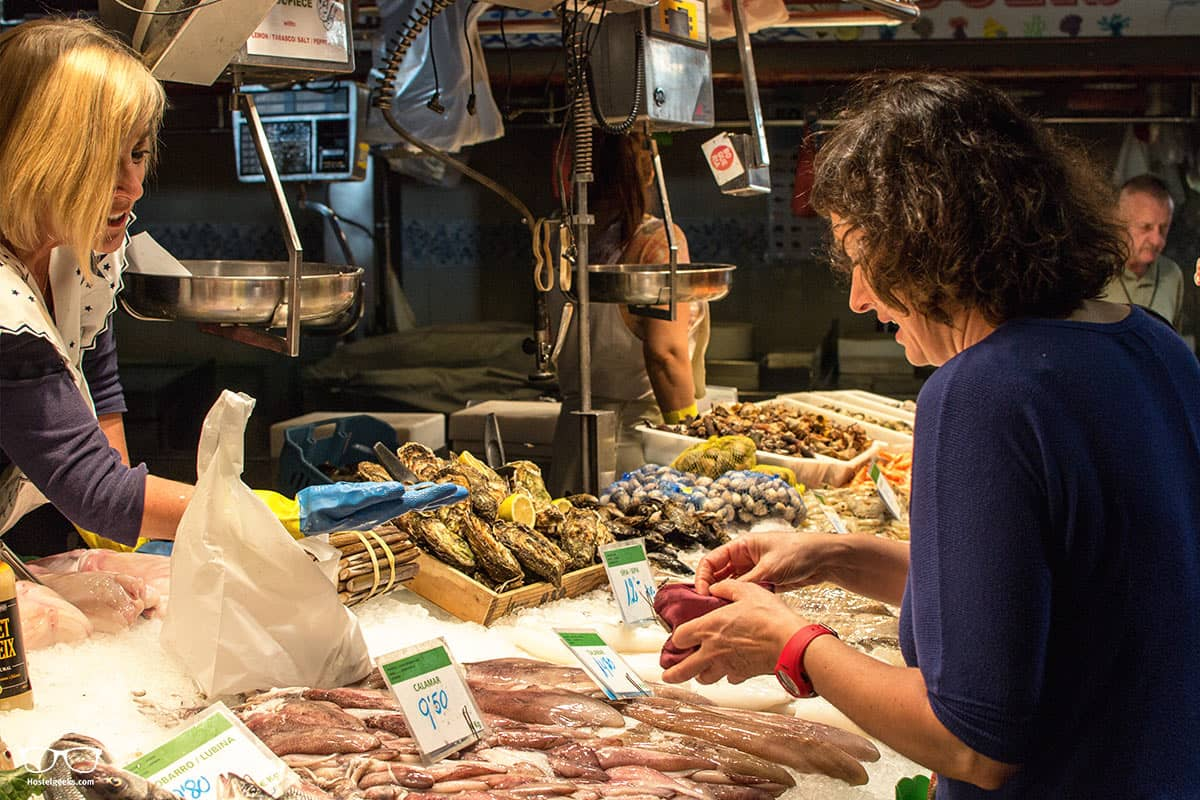 Getting the last ingredients for the delicious Paella with Foodie Experience Barcelona