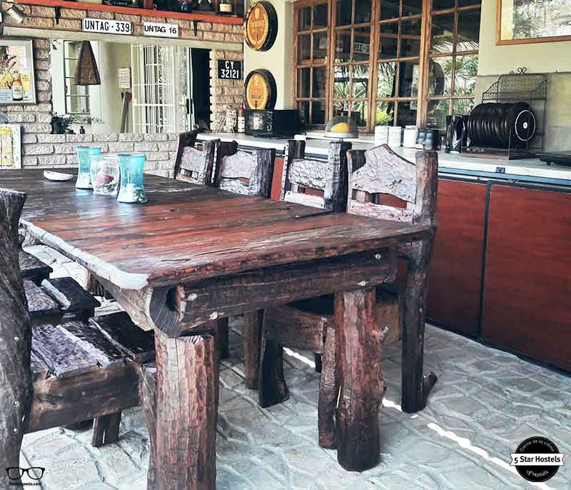 Wooden tables and outdoor kitchen