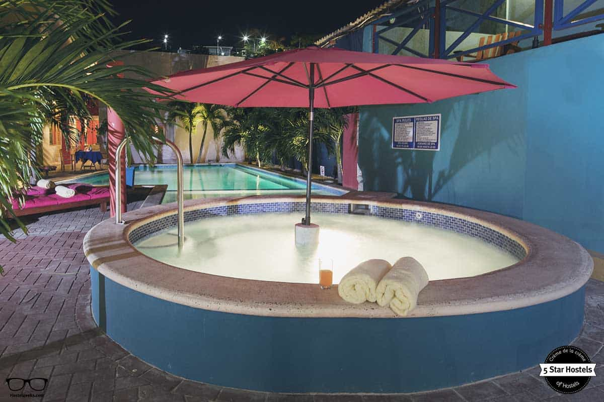 Enjoy the jacuzzi at The Ritz Village Hostel Curacao