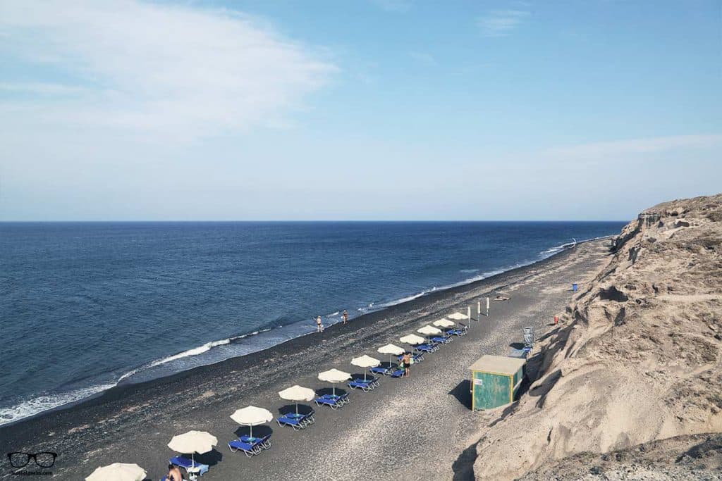 Sunbathing on the black beach of Kamari beach