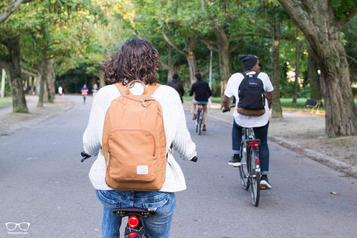 Enjoying a park ride through Amsterdam, bike rent at Ecomama