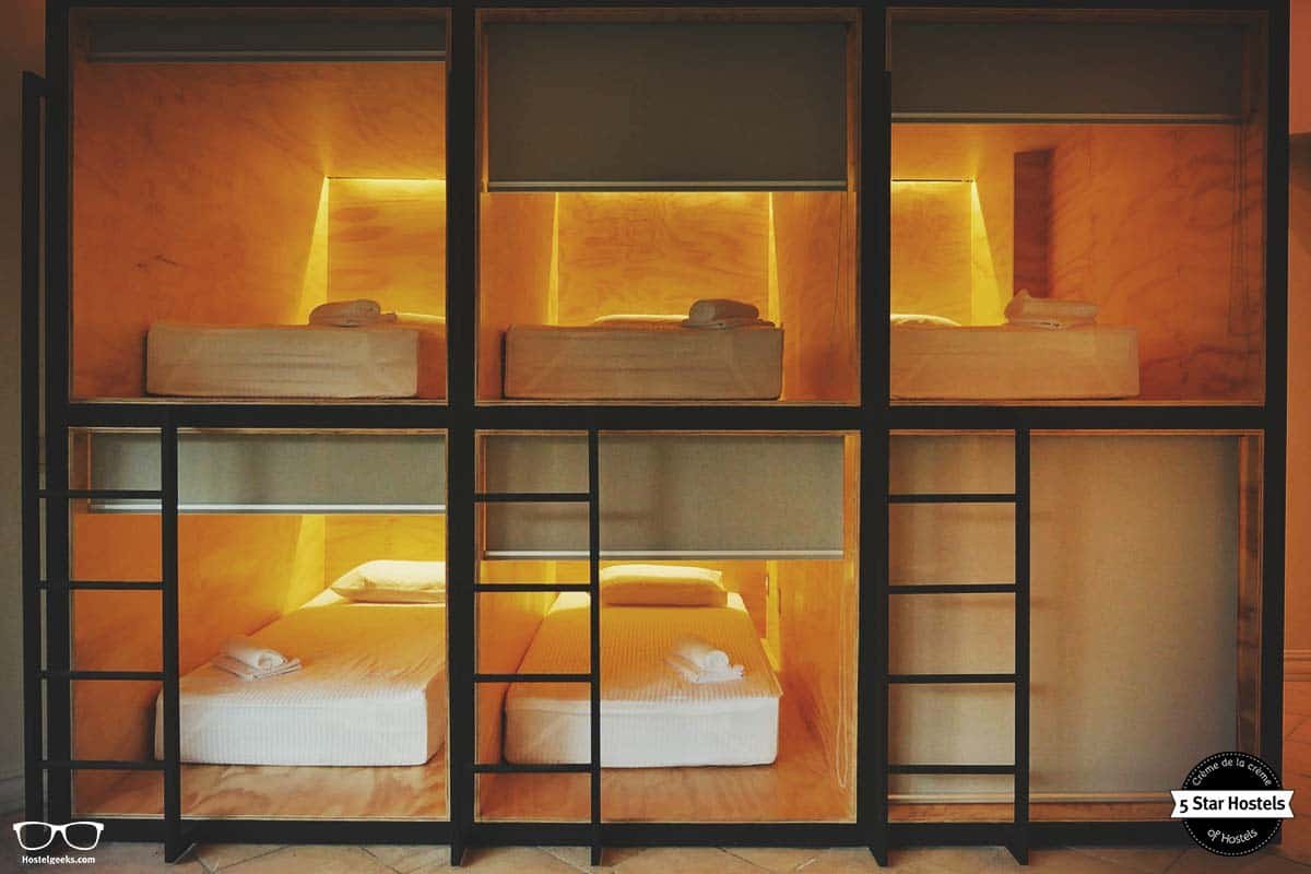 Sleep in capsule beds at Fauna Luxury Hostel