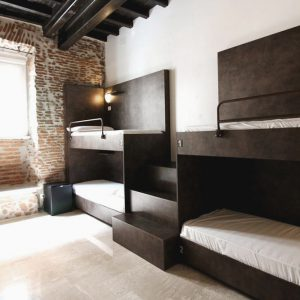 Old walls and modern design at New Generation Santa Maria Maggiore, Rome