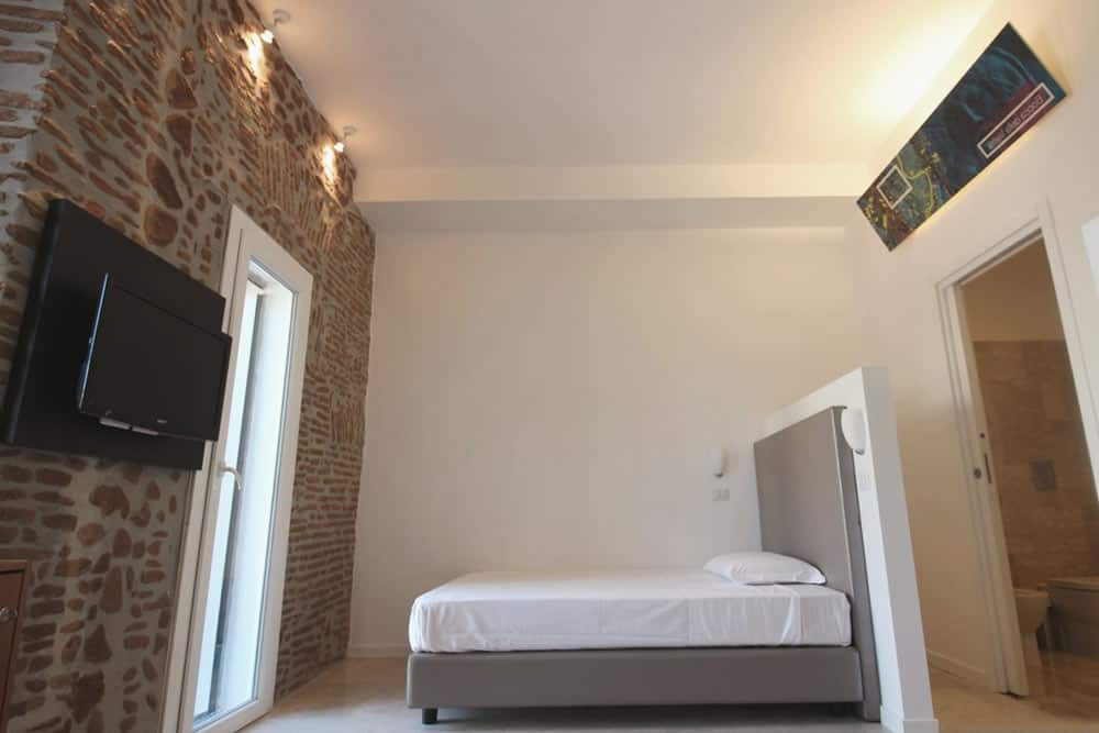 Get cozy at the private room at New Generation Hostel in Rome