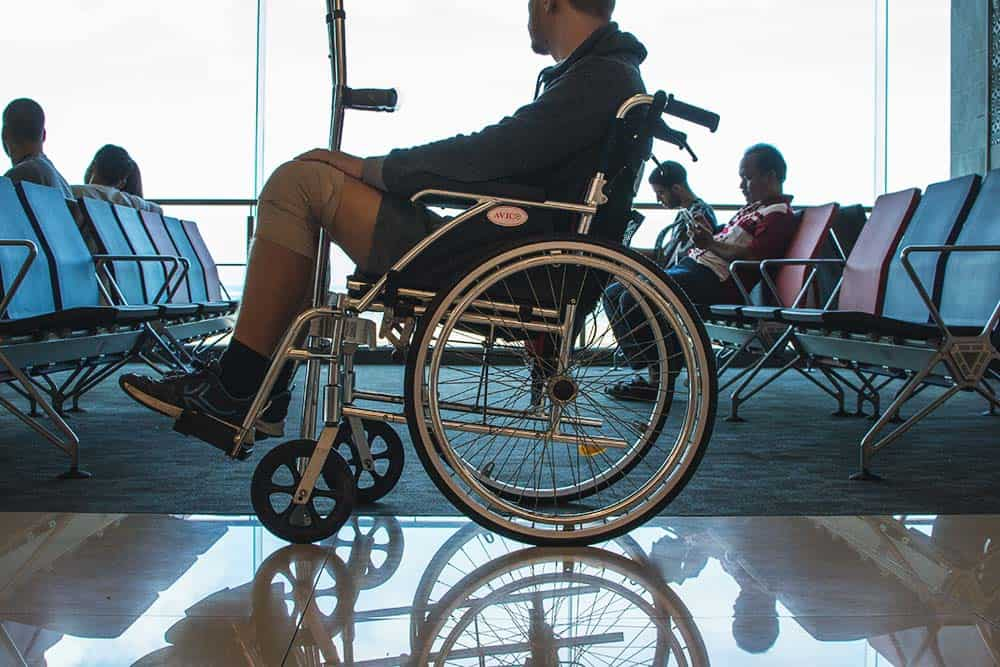 Not a staged photo: Matt in a wheelchair after the accident in Bali