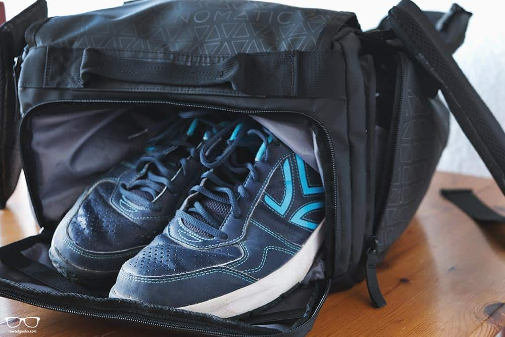 A backpack with a separated compartment for shoes or bulky items