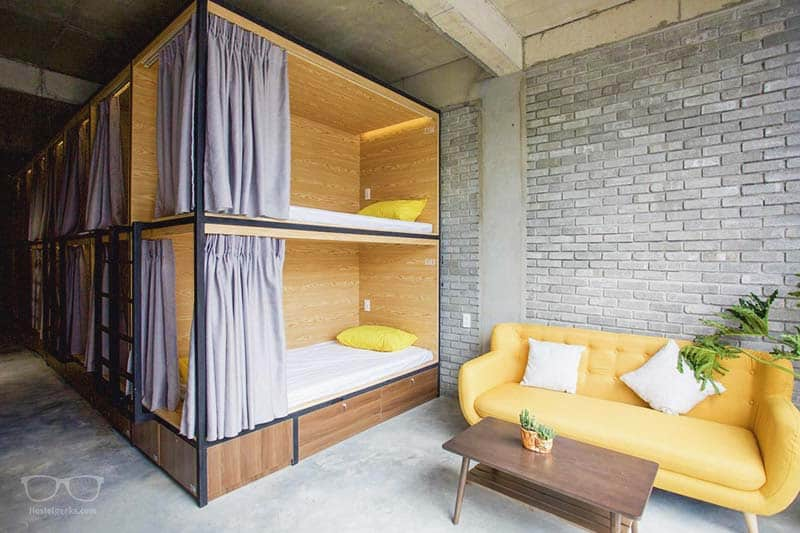 Super cool dorm with stylish bunk beds at The VIetnam Hostel, one of the Da Nang Hostels