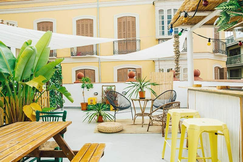 Enjoy the roof top terrace at Urban jungle Hostel in Malaga