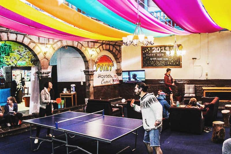 Enjoy indoor games like table tennis at The Point Hostel Cusco