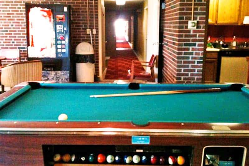 Beat your new hostel mate in billiards at Backpackers Hostel and Pub