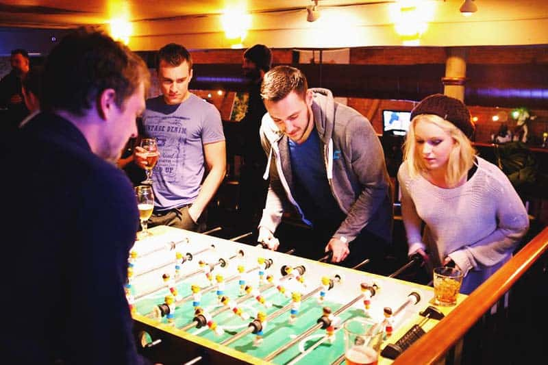Join the other guest and play Foosball in the game room at the Green Tortoise Hostel
