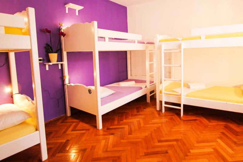 Bright colored rooms at Helvetia Hostel