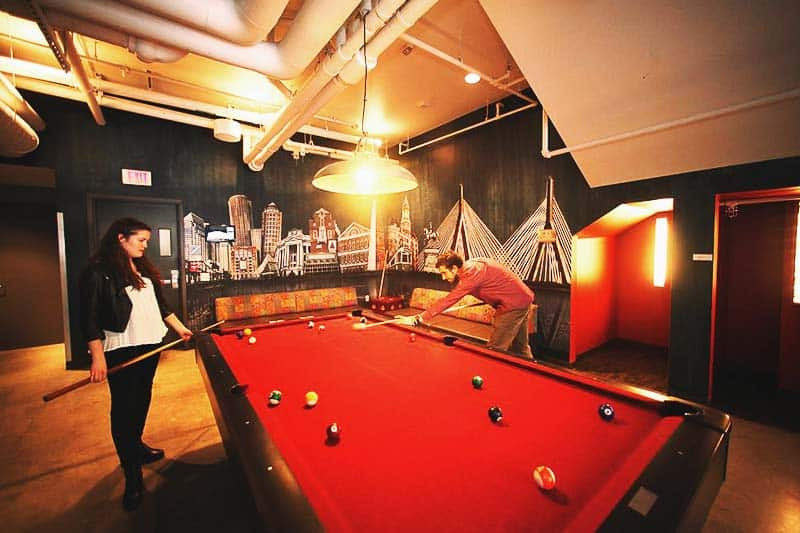 Grab your friend and play billiards in HI Boston Hotel's play room