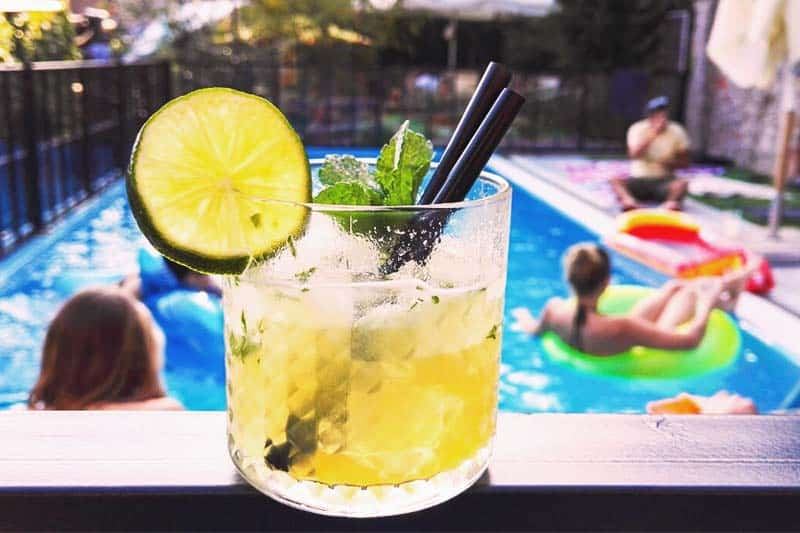 Have your drinks by the pool at Swanky Mint Hostel