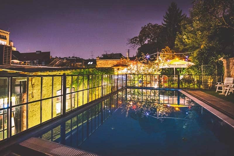 Take a night dip at the Swanky Mint Hostel rooftop pool
