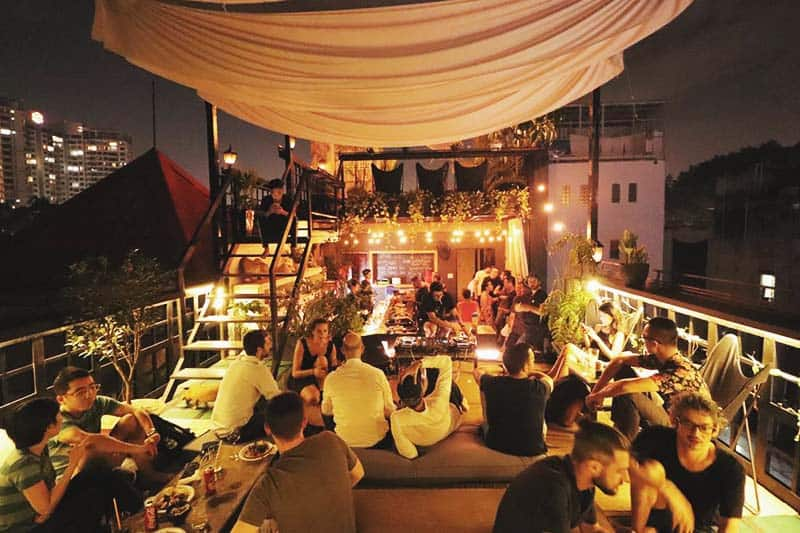 Take a sip of your ice cold drink at The Common Room Project rooftop bar