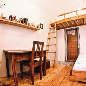 Get a chance to experience how its like to stay in a prison cell at Hostel Celica