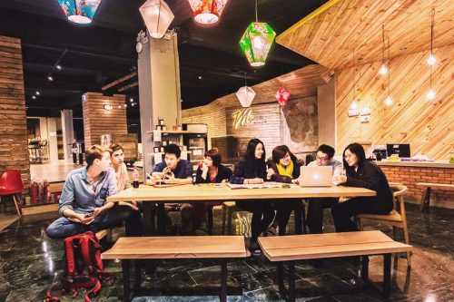 Kill time and mingle with other guests at Meander Taipei Hostel lounge