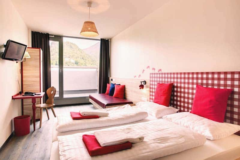 Rooms are lighted with big glass windows at Meininger Salzburg