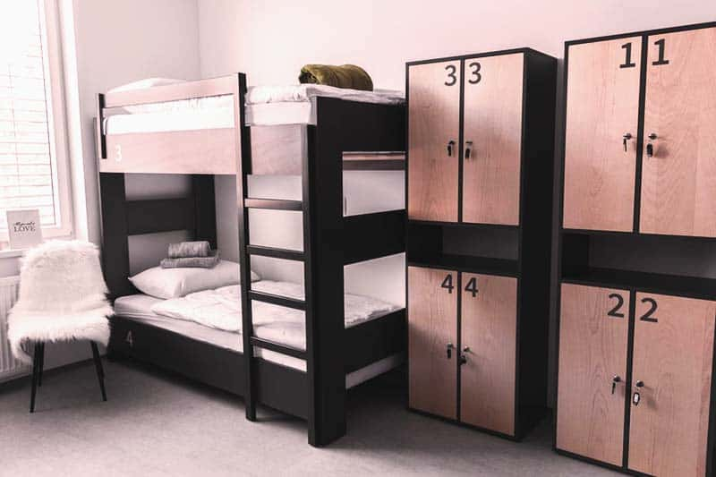 Rooms at KVA Hostel are colored with black and gray making it very clean to see