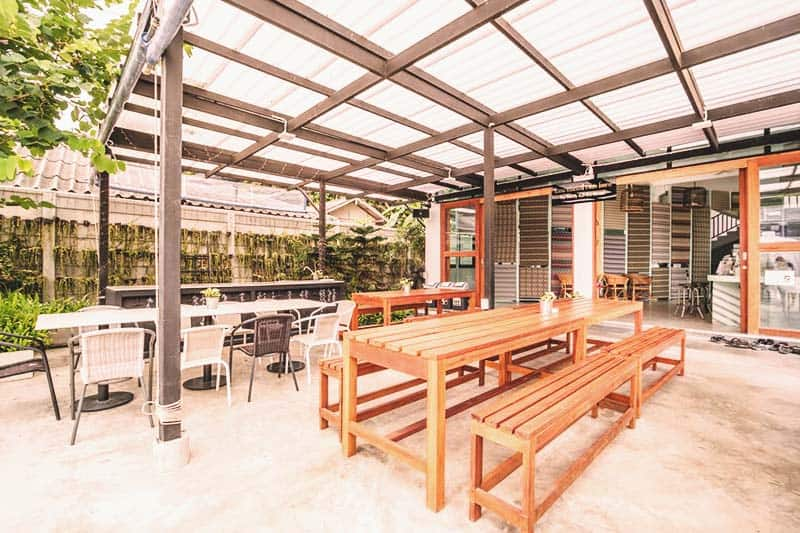 Have your meals at The Dearly Koh Tao Hostel's outdoor common area