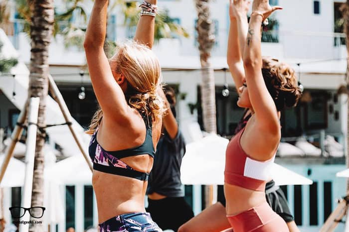 Feel fit and join in a yoga class at Kos One Hostel in Canggu, Indonesia