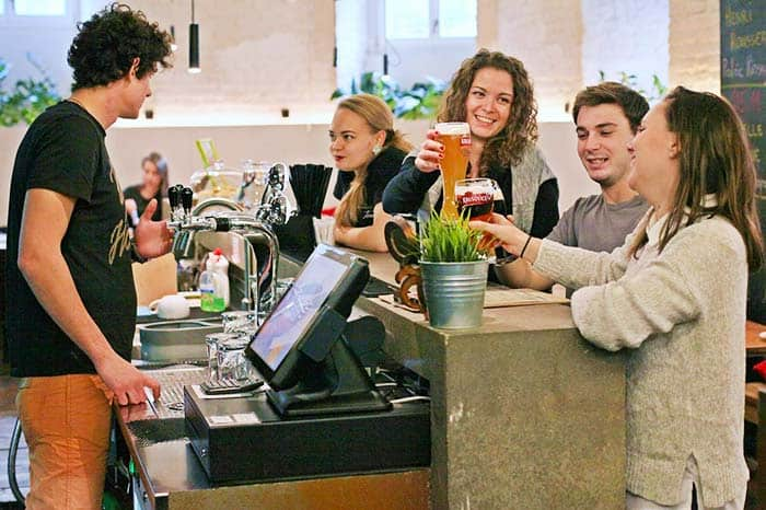 Have a drink with friends at the Sophie's Hostel Bar