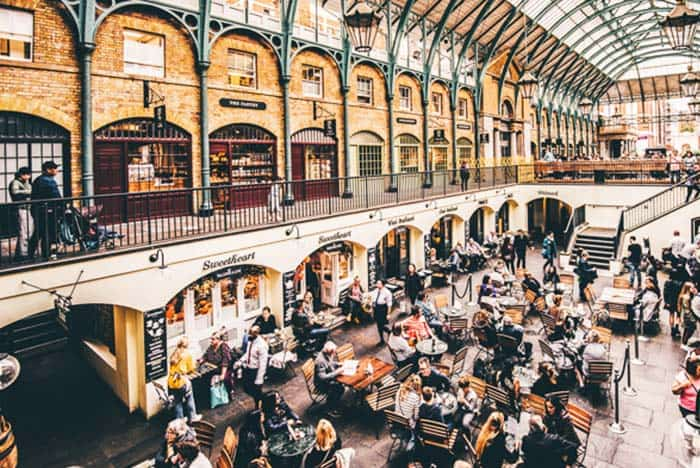 Go on a food trip or listen to musicians in Covent Garden