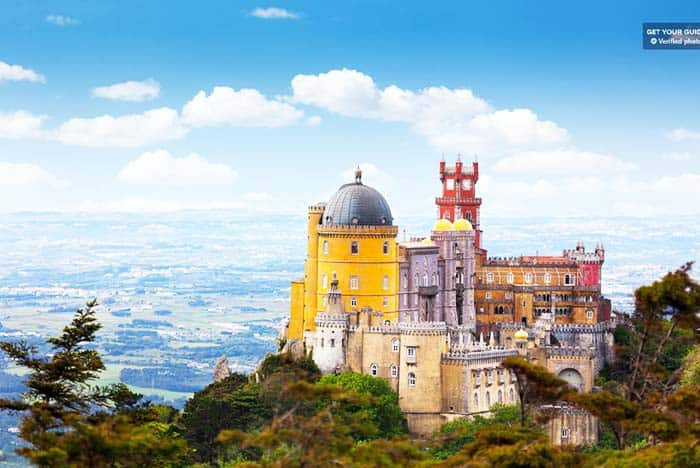 Visit the colorful Pena Palace on your trip to Lisbon