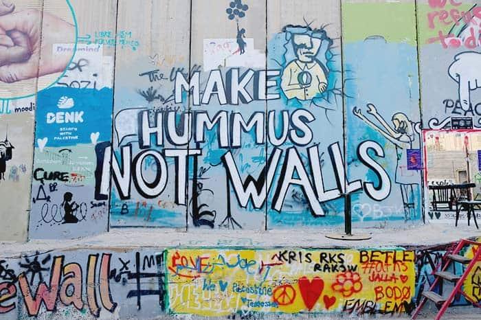Make Hummus not walls - a Graffiti at the separation Wall of Israel and West Bank