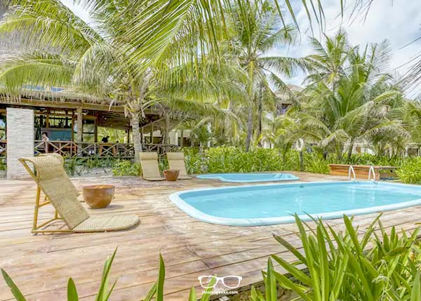 Dip in a pool? Selina Hostel comes with a front-door beach and a swimming pool